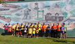 All 2018 Potomac Street Mile Winners in front of the Brunswick mural, Square Corner Park