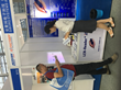 A visitor learns about LCR-Reader-MPA at Nepcon Asia