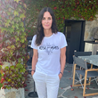 Courteney Cox wearing #RiseFromTheAshes T-Shirt