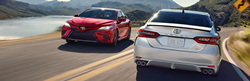 Two 2020 Toyota Camry models in red and white