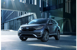 2020 Honda CR-V Hybrid exterior shot with gray blue paint color parked in an empty industrial area