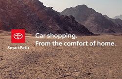 "An image of a mountain landscape with the caption ""Car Shopping. From the comfort of home."" with the Toyota SmartPath logo."