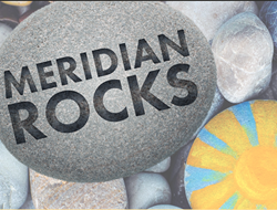 "River Rock with the text ""Meridian Rocks"" inscripted on it."