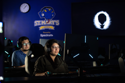 St. Mary's University Esports Head Coach Kaitlin Teniente in the foreground and Assistant Coach Mack Moncada test drive the new St. Mary's Esports Arena.