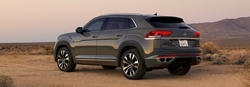 Rear driver angle of a grey 2020 Volkswagen Atlas Cross Sport parked in a desert