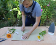 Allison Zeeb, co-owner of NoFarmNeeded, creates a pressed flower design.