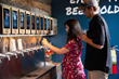 Customers using iPourIt GEN 4 self-pour taps at Pour Taproom Atlanta