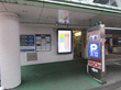 The Display Shield Portrait Outdoor Signage Case in a Parking Garage in Japan