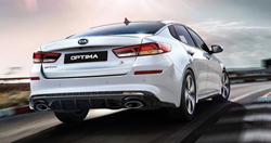 2020 Kia Optima rear view driving on a track_o