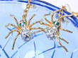 A pair of creepy yet elegant earrings with dangling spiders that bring all the fun to the 31st festivities.