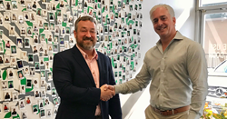 Craig Bevington, owner of 2nd Family of North Dallas, and Chad Tracey, President of 2nd Family shake hands on an agreement to open a 2nd Family location in north Dallas.