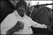 "General TC calls himself ""The Peoples' General and lives on the sidewalk on Skid Row. 2014, Los Angeles. The David Bacon Archive, Department of Special Collections, Stanford Libraries."