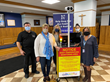 Nazareth Academy Principal Therese Hawkins and Registerd Nurse Kathy Gross accept DuThermX Mobile Cart donation from Dubak Electrical Group officials.
