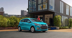 teal 2021 Chevrolet Spark with a person