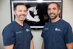 Drs. Dan Holtzclaw and Juan Gonzalez, Dental Implant Specialists in Austin, TX