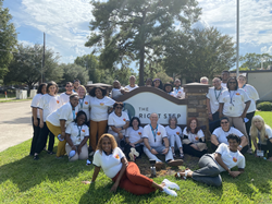 The Right Step Houston staff stand in front of treatment center sign in celebration