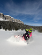 Snowmobilers enjoy the 2 million acres of scenic Shoshone National Forest backcountry riding and 600 miles of groomed trails surrounding Brooks Lake Lodge.