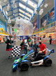 World's largest children's museum features two race car drivers in holiday parade.