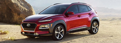2021 Hyundai Kona EV exterior front fascia driver side in front of rocks
