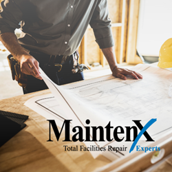 A white man in a gray button down shirt leans on a drafting table holding building plans in his right hand. The MaintenX International logo is displayed over the image in the bottom right corner.