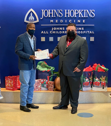 Jason Labossiere reached out to Senator Darryl Rouson to ensure terminally ill children at all children's hospital have something to smile about this Christmas