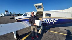 Volunteer pilot Robby Hill prepares to fly COVID19 supplies