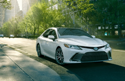 2021 Toyota Camry going down the road