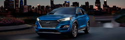 Blue 2021 Hyundai Tucson on a City Street at Night