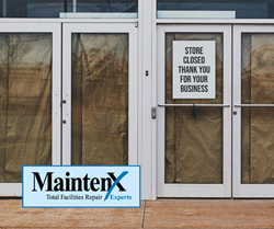"Four store doors are covered with brown paper and a sign in the window reads: ""Store Closed. Thank you for your business."""