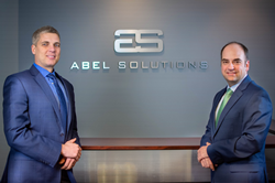 Pedro Speed and Glen Feucht at the Abel Solutions office in Alpharetta, GA.