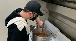 Man cooking stew for a food pantry.