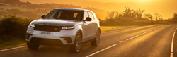 Silver 2021 Range Rover Velar on a Country Road at Sunrise