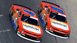 Two racecars featuring MaintenX branded wraps on a racetrack.