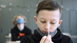 Student self collecting swab sample by Copper Hound Pictures