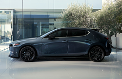 The side view of a gray 2021 Mazda3 Hatchback Turbo.