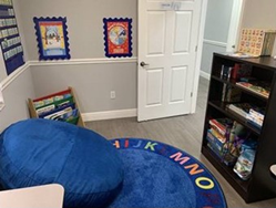 A CARD therapy room with books, toys, and games.