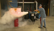 man using fire extinguisher in an industrial workplace