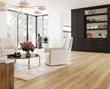 Living area with hickory wide plank wood flooring