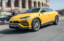 yellow 2021 Lamborghini Urus front and side view