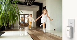Family entering home, kids running down hallway, Ting sensor plugged into an outlet in the foreground