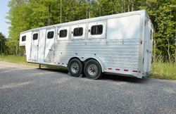 large trailer parked on the side of a road