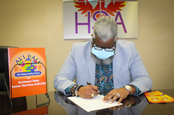 Northeast Delta Human Services Authority Executive Director Dr. Monteic A. Sizer signs the agreement with Delta Head Start to facilitate the provision of Al's Pals: Kids Making Healthy Choices.