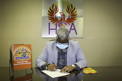 Northeast Delta Human Services Authority Executive Director Dr. Monteic A. Sizer the agreement with Madison Parish School District.