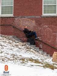 Veteran using the iBOT personal mobility device to go down stairs.